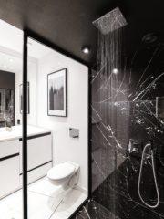 """Не можеш да постигнеш усещане за луксозен имот, ако направиш компромис с банята. Стъклена витрина от черни метални профили """"разцепва"""" оптично пространството на две – черна и бяла част. В черната е изпълнена душ-кабина с широчина 150см и душ-пита, вградена в тавана. В бялата част е цялото останало оборудване, което очаквате да намерите в една баня. Сюреализмът на помещението се допълва от огромното от пода до тавана огледало и черно-бяла картина."""