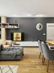 Светлите тонове в комбинация с естествения цвят на дъба внасят лекота, а тъмносивата стена създава дълбочина.